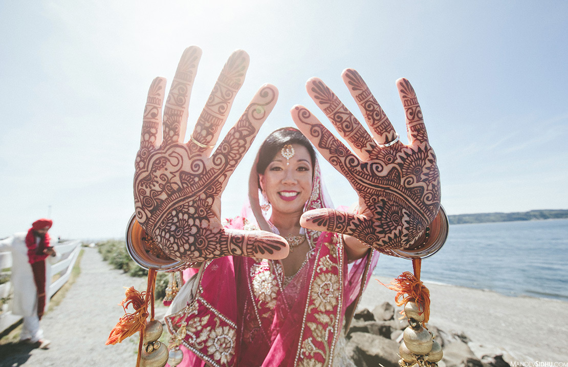 Asian bride mendhi henna on hands at beach in Seattle