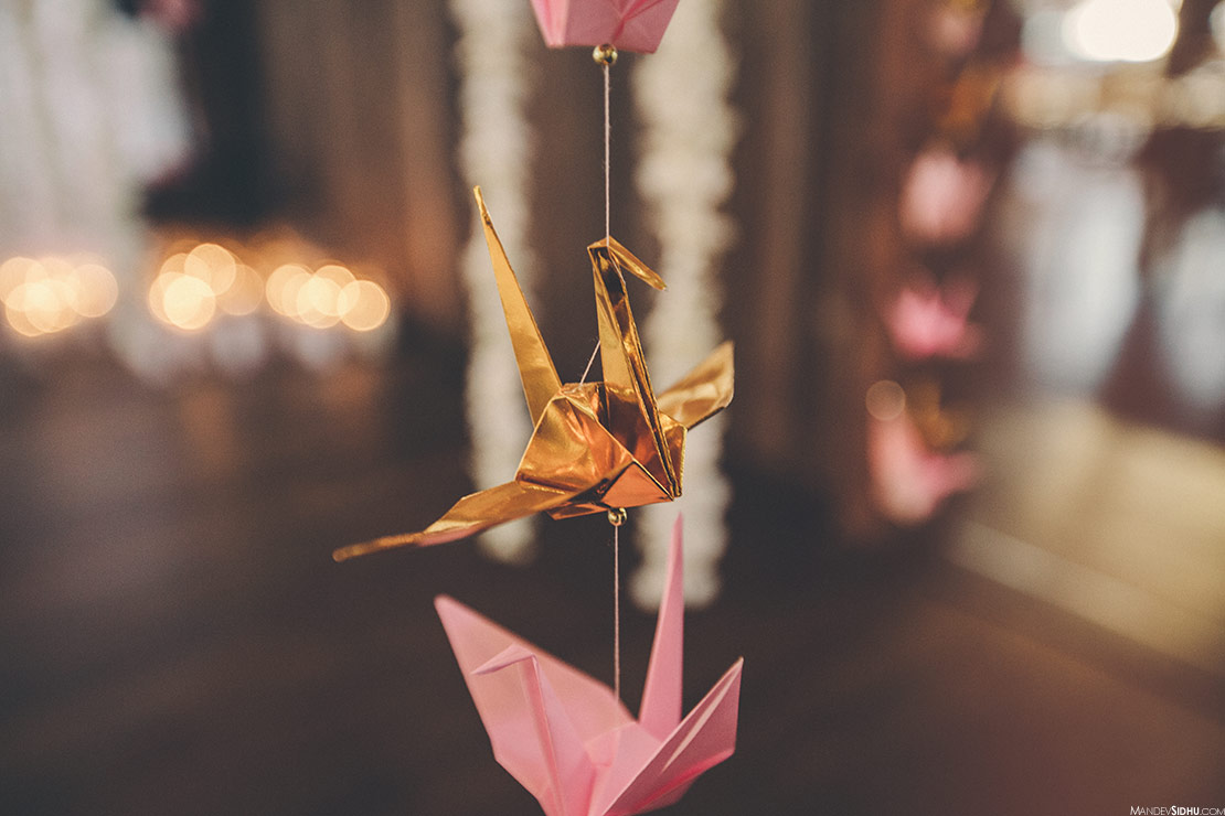 Indian-Asian wedding decorations flower garlands and paper cranes