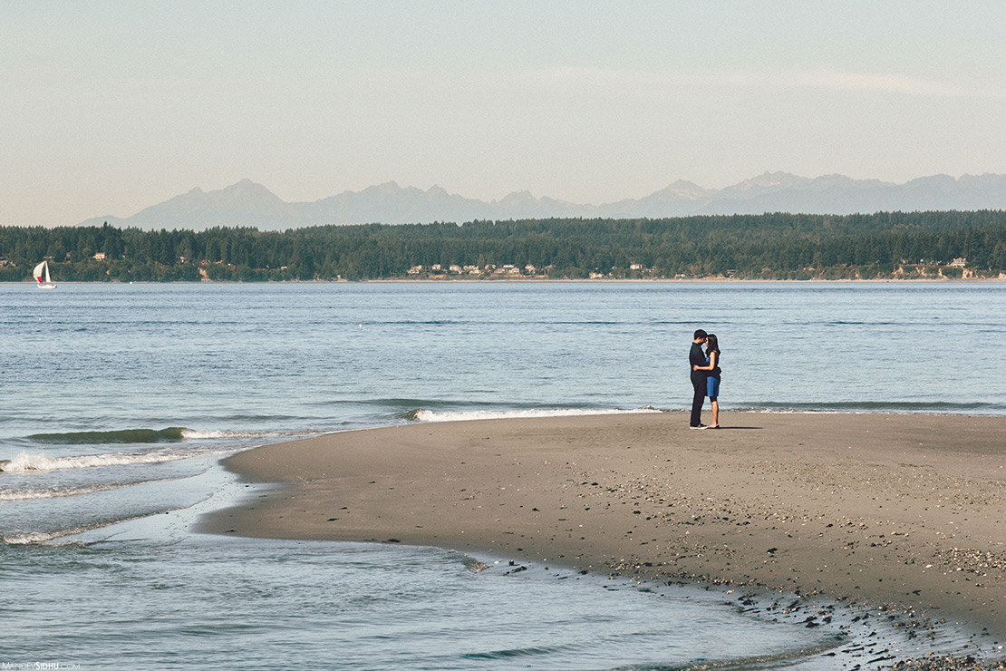 couple standing on a sand bar at the beach in Seattle - Discovery Park Engagement Photos