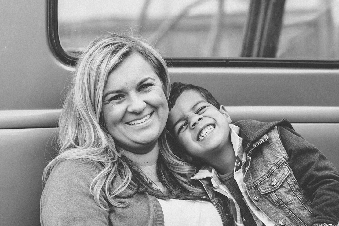 mom and son sitting in back of pickup truck for their Fall family photos
