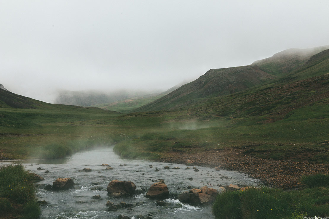 Hiking to Geothermally heated stream in Iceland
