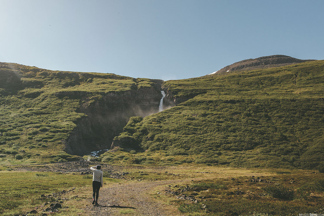hiking to waterfall in iceland